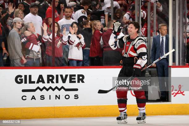 Shane Doan of the Arizona Coyotes waves to fans as he skates off the ice following the NHL game against the Minnesota Wild at Gila River Arena on...