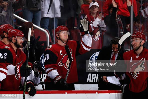Shane Doan of the Arizona Coyotes waves to the fans after the annoucenment of his franchise leading 930th point registered during the second period...