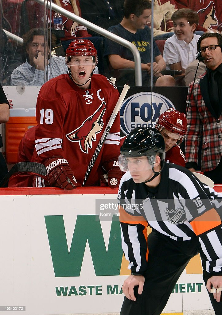 Shane Doan #19 of the Arizona Coyotes yells out to an official during the third period of an HNL game against the San Jose Sharks at Gila River Arena on February 13, 2015 in Glendale, Arizona.