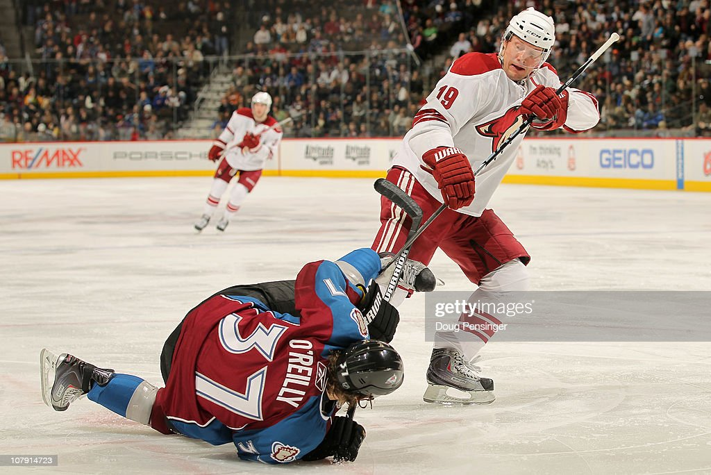 Shane Doan of the Phoenix Coyotes and Ryan O'Reilly of the Colorado Avalanche get their sticks tangled after a face off at the Pepsi Center on...