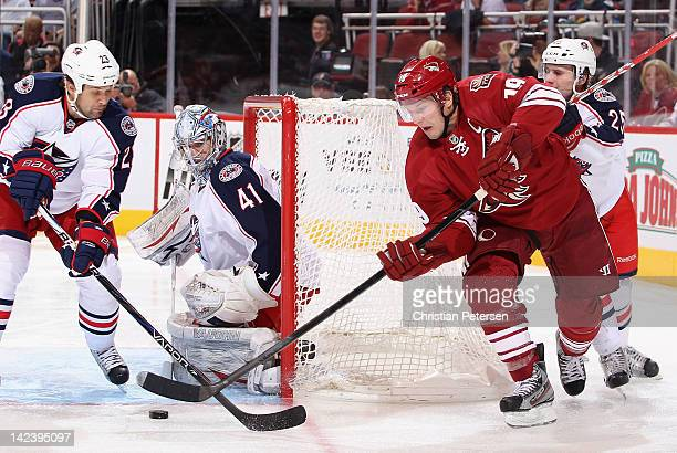 Shane Doan of the Phoenix Coyotes attempts a wrap around shot on goaltender Allen York of the Columbus Blue Jackets during the second period of the...