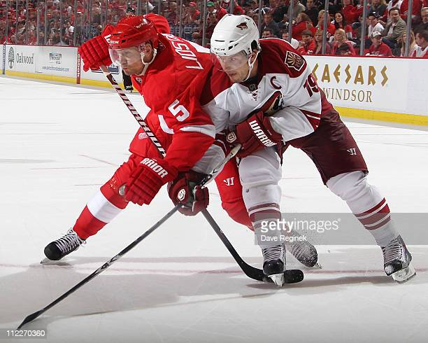 Shane Doan of the Phoenix Coyotes battles for position with Nicklas Lidstrom of the Detroit Red Wings in Game Two of the Western Conference...