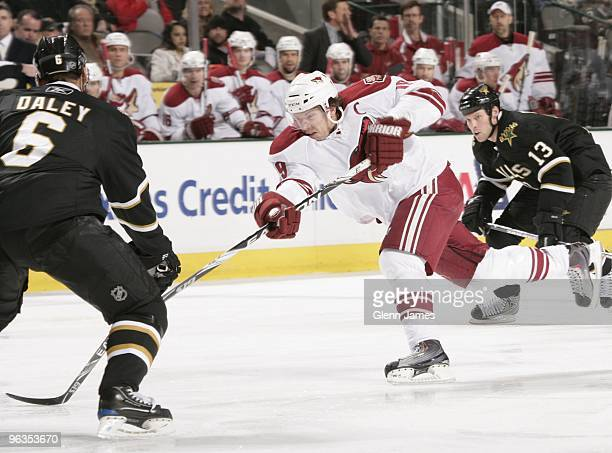 Shane Doan of the Phoenix Coyotes blasts a shot on goal against Trevor Daley of the Dallas Stars on January 31 2010 at the American Airlines Center...