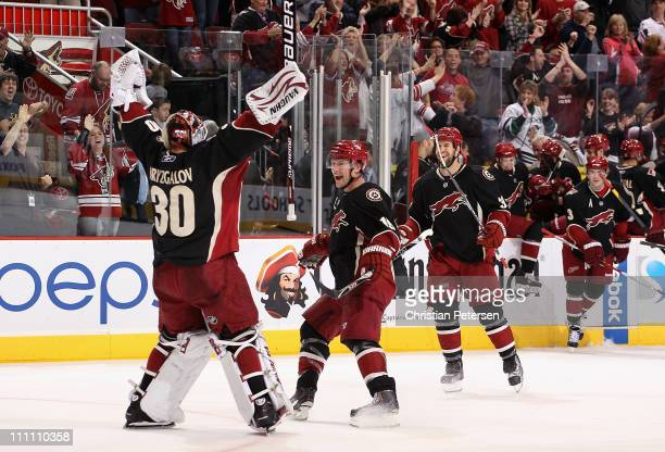 Shane Doan of the Phoenix Coyotes celebrates with goaltender Ilya Bryzgalov after defeating the Dallas Stars in an overtime shoot out following the...