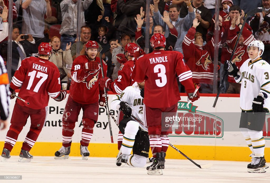 Shane Doan of the Phoenix Coyotes celebrates with teammates Radim Vrbata Daymond Langkow and Keith Yandle after Doan scored a third period goal and...