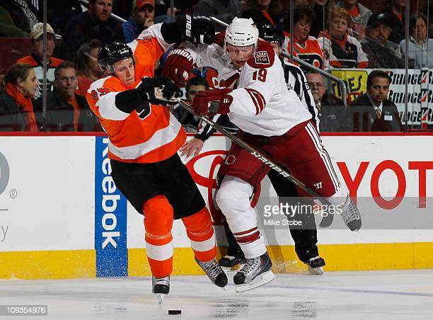 Shane Doan of the Phoenix Coyotes collides with Matt Carle of the Philadelphia Flyers on February 22 2011 at the Wells Fargo Center in Philadelphia...