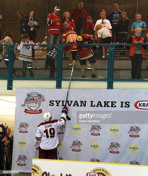 Shane Doan of the Phoenix Coyotes gives his stick to a fan as he leaves the ice during Day 4 of NHL Kraft Hockeyville at the Sylvan Lake Multiplex on...