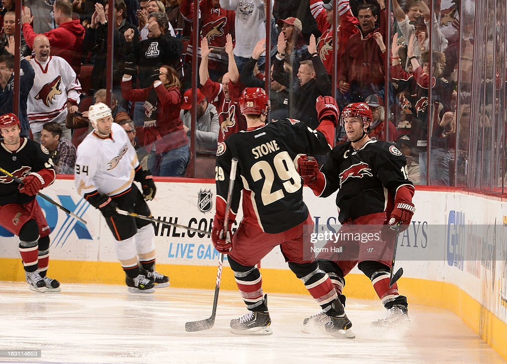 <a gi-track='captionPersonalityLinkClicked' href=/galleries/search?phrase=Shane+Doan&family=editorial&specificpeople=201614 ng-click='$event.stopPropagation()'>Shane Doan</a> #19 of the Phoenix Coyotes is congraulated by teammate Michael Stone #29 after Doan's third period goal against the Anaheim Ducks at Jobing.com Arena on March 4, 2013 in Glendale, Arizona. It was Doan's 800th career point.