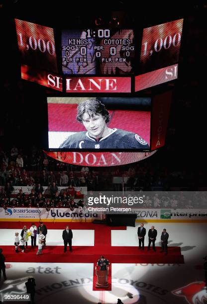 Shane Doan of the Phoenix Coyotes is honored before the game against the Los Angeles Kings for playing in 1000 career NHL games at Jobingcom Arena on...