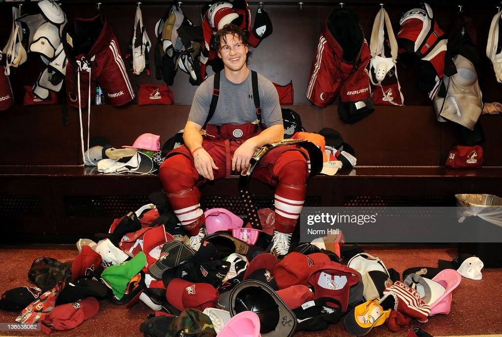 Shane Doan of the Phoenix Coyotes is presented with the hats thrown on the ice after recording his first career NHL hat trick against the New York...