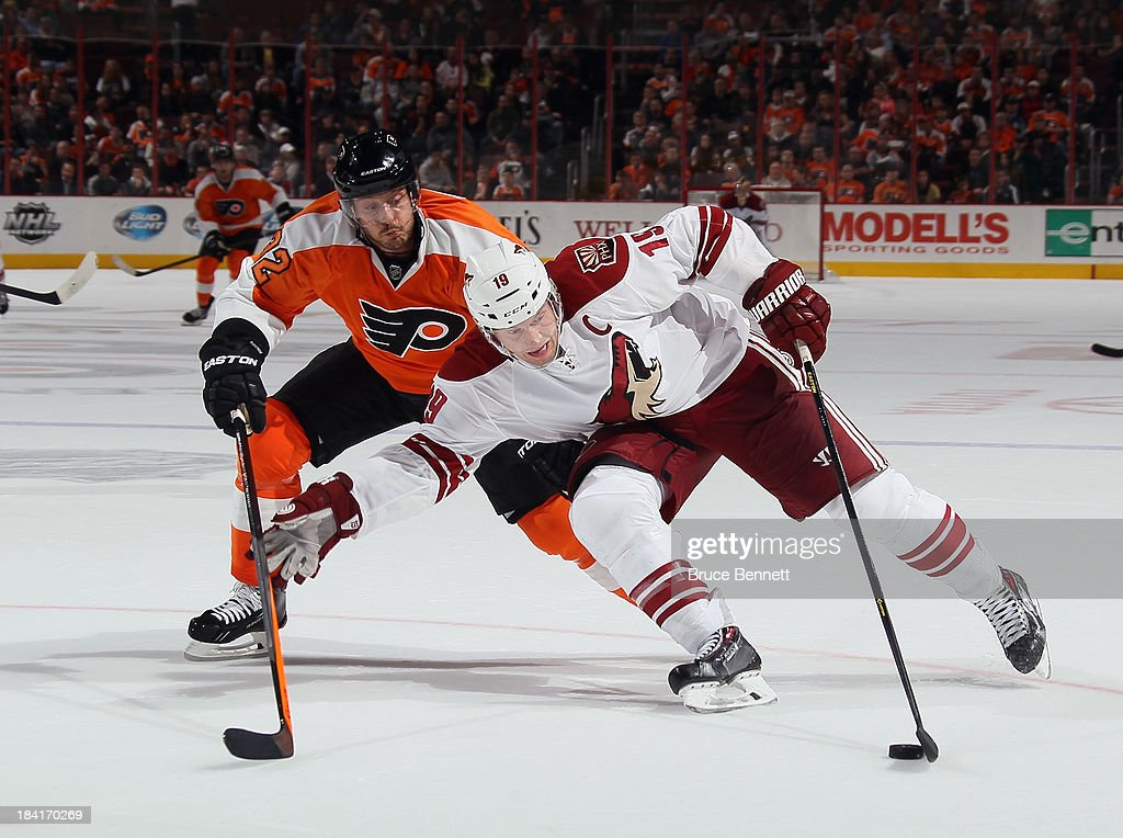 Shane Doan #19 of the Phoenix Coyotes moves around Mark Streit #32 of the Philadelphia Flyers during the third period at the Wells Fargo Center on October 11, 2013 in Philadelphia, Pennsylvania. The Coyotes defeated the Flyers 2-1.