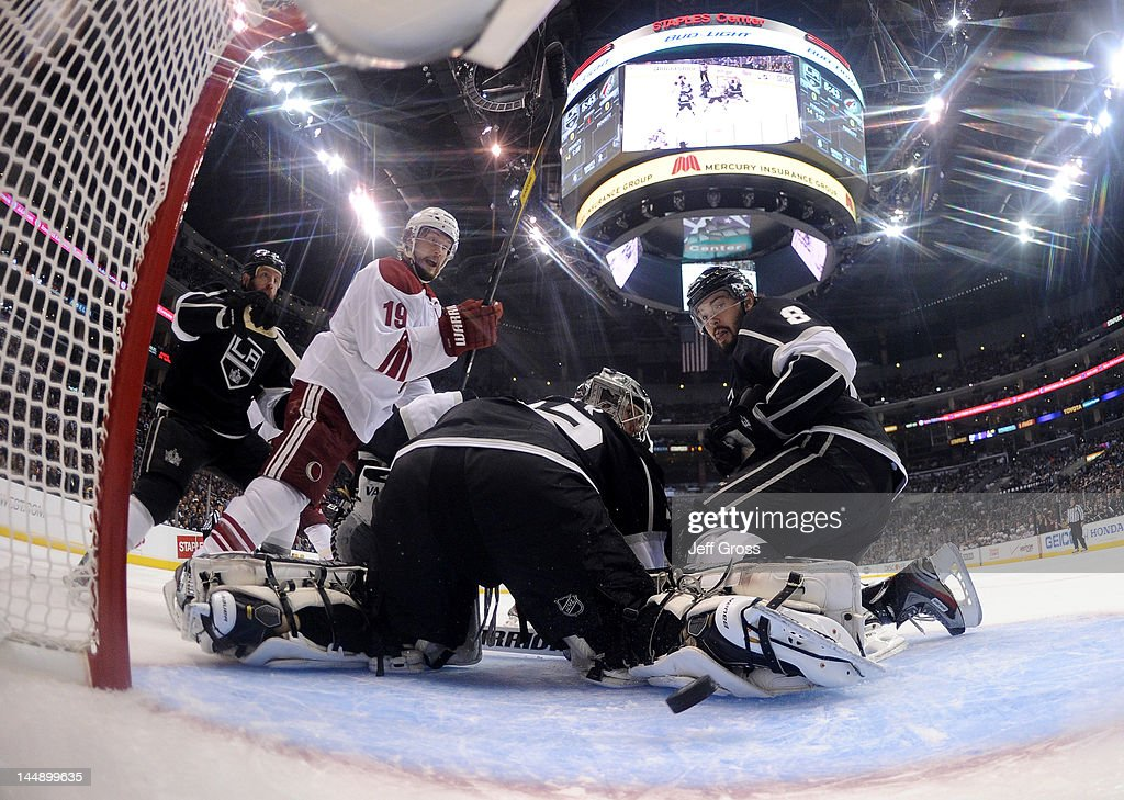 <a gi-track='captionPersonalityLinkClicked' href=/galleries/search?phrase=Shane+Doan&family=editorial&specificpeople=201614 ng-click='$event.stopPropagation()'>Shane Doan</a> #19 of the Phoenix Coyotes scores a power play goal in the first period past goaltender <a gi-track='captionPersonalityLinkClicked' href=/galleries/search?phrase=Jonathan+Quick&family=editorial&specificpeople=2271852 ng-click='$event.stopPropagation()'>Jonathan Quick</a> #32 of the Los Angeles Kings in Game Four of the Western Conference Final during the 2012 NHL Stanley Cup Playoffs at Staples Center on May 20, 2012 in Los Angeles, California.