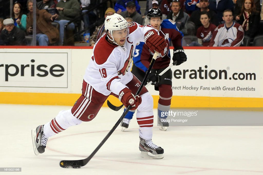 <a gi-track='captionPersonalityLinkClicked' href=/galleries/search?phrase=Shane+Doan&family=editorial&specificpeople=201614 ng-click='$event.stopPropagation()'>Shane Doan</a> #19 of the Phoenix Coyotes shoots to score the game winning goal in overtime against the Colorado Avalanche at the Pepsi Center on February 11, 2013 in Denver, Colorado. The Coyotes defeated the Avalanche 3-2 in overtime.