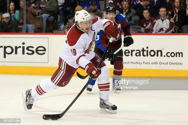 Shane Doan of the Phoenix Coyotes shoots to score the game winning goal in overtime against the Colorado Avalanche at the Pepsi Center on February 11...