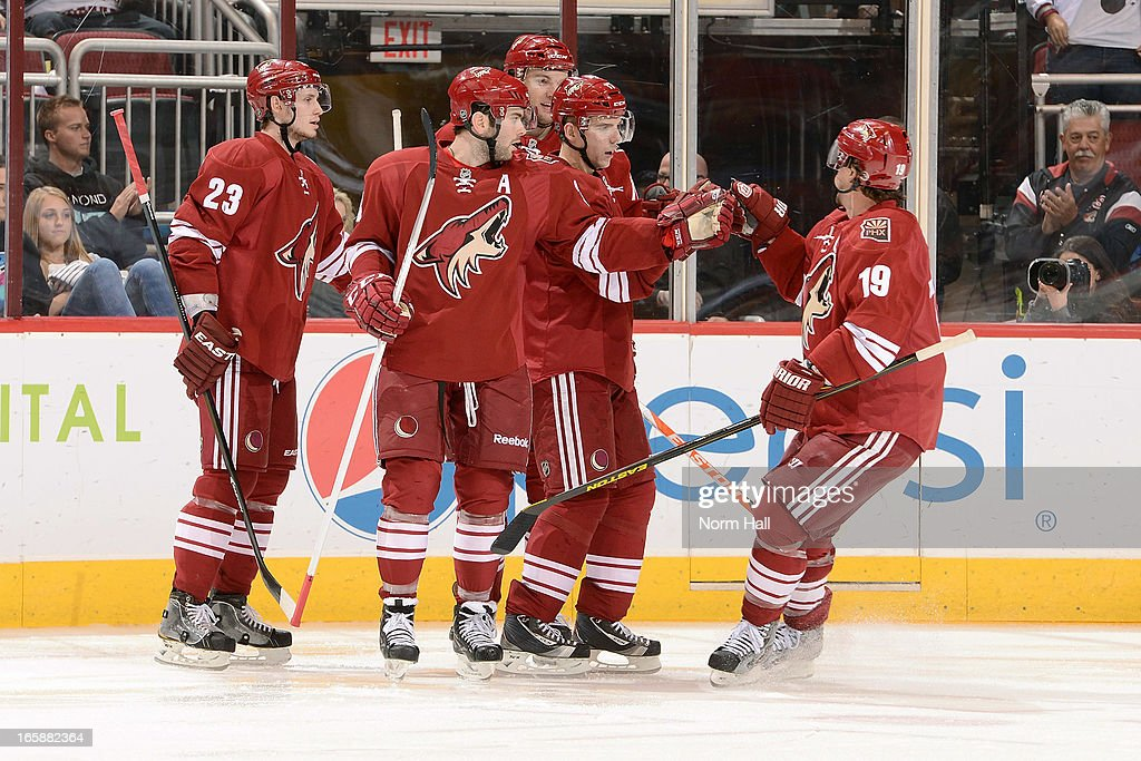 <a gi-track='captionPersonalityLinkClicked' href=/galleries/search?phrase=Shane+Doan&family=editorial&specificpeople=201614 ng-click='$event.stopPropagation()'>Shane Doan</a> #19 of the Phoenix Coyotes skates in to congratulate teammates <a gi-track='captionPersonalityLinkClicked' href=/galleries/search?phrase=Oliver+Ekman-Larsson&family=editorial&specificpeople=5894618 ng-click='$event.stopPropagation()'>Oliver Ekman-Larsson</a> #23, <a gi-track='captionPersonalityLinkClicked' href=/galleries/search?phrase=Keith+Yandle&family=editorial&specificpeople=606912 ng-click='$event.stopPropagation()'>Keith Yandle</a> #3, <a gi-track='captionPersonalityLinkClicked' href=/galleries/search?phrase=Martin+Hanzal&family=editorial&specificpeople=2109469 ng-click='$event.stopPropagation()'>Martin Hanzal</a> #11 and <a gi-track='captionPersonalityLinkClicked' href=/galleries/search?phrase=Radim+Vrbata&family=editorial&specificpeople=204716 ng-click='$event.stopPropagation()'>Radim Vrbata</a> #17 after a second period goal against the Colorado Avalanche at Jobing.com Arena on April 6, 2013 in Glendale, Arizona.