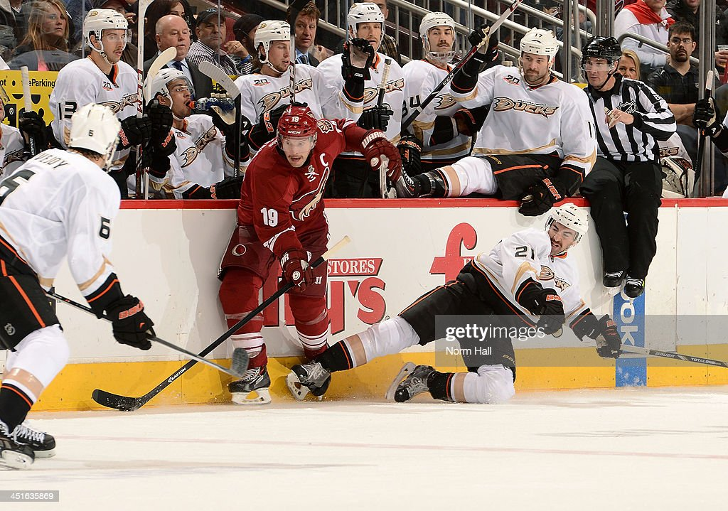 <a gi-track='captionPersonalityLinkClicked' href=/galleries/search?phrase=Shane+Doan&family=editorial&specificpeople=201614 ng-click='$event.stopPropagation()'>Shane Doan</a> #19 of the Phoenix Coyotes skates the puck along the boards past <a gi-track='captionPersonalityLinkClicked' href=/galleries/search?phrase=Kyle+Palmieri&family=editorial&specificpeople=4783296 ng-click='$event.stopPropagation()'>Kyle Palmieri</a> #21 of the Anaheim Ducks as <a gi-track='captionPersonalityLinkClicked' href=/galleries/search?phrase=Ben+Lovejoy&family=editorial&specificpeople=4509565 ng-click='$event.stopPropagation()'>Ben Lovejoy</a> #6 of the Ducks defends during the second period at Jobing.com Arena on November 23, 2013 in Glendale, Arizona.