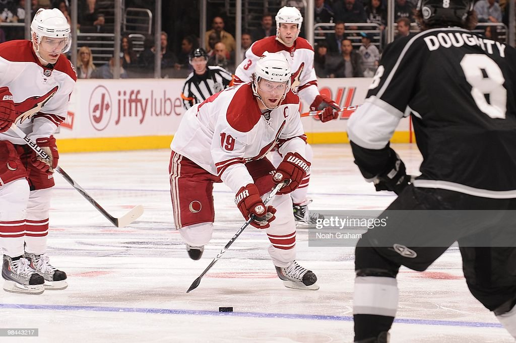 Shane Doan of the Phoenix Coyotes skates with the puck against Drew Doughty of the Los Angeles Kings on April 8 2010 at Staples Center in Los Angeles...