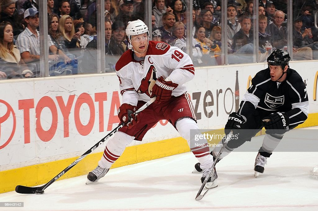 Shane Doan of the Phoenix Coyotes skates with the puck against Rob Scuderi of the Los Angeles Kings on April 8 2010 at Staples Center in Los Angeles...