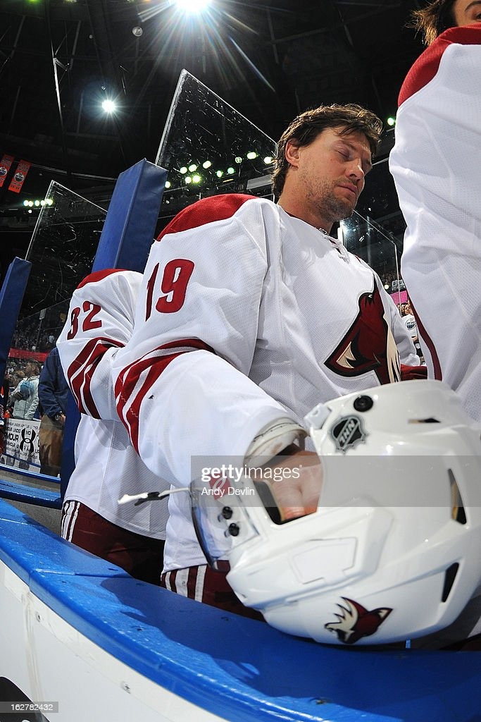 Shane Doan #19 of the Phoenix Coyotes stands for the singing of the national anthem prior to a game against the Edmonton Oilers on February 23, 2013 at Rexall Place in Edmonton, Alberta, Canada.