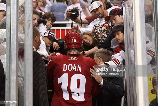 Shane Doan of the Phoenix Coyotes walks off the ice after being defeated by the Detroit Red Wings in Game Four of the Western Conference...