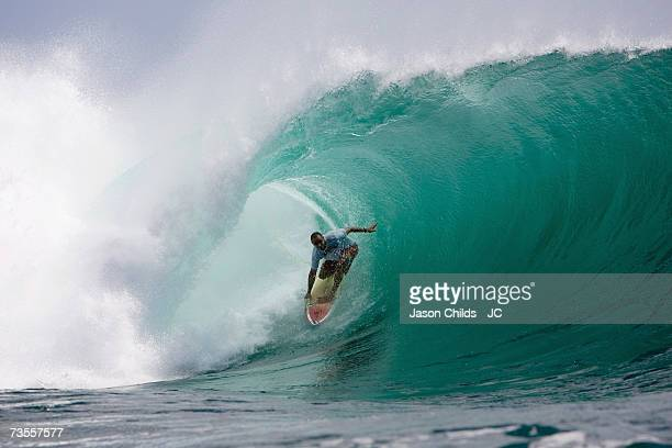 Shane Dorian from the USA rides the tube at Padang Padang July 7 2006 in Bali Indonesia