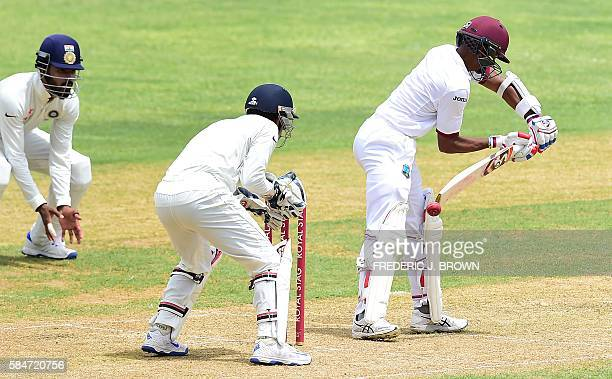 Shane Dowrich of the West Indies was caught out by India wicket keeper Wriddhiman Saha off a delivery from bowler Ravichandran Ashwin on July 30 2016...