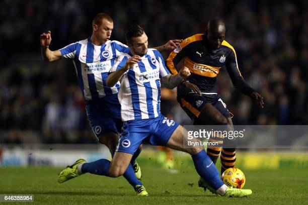 Shane Duffy of Brighton and Hove Abion clashes with Mohamed Diame of Newcastle United during the Sky Bet Championship match between Brighton Hove...