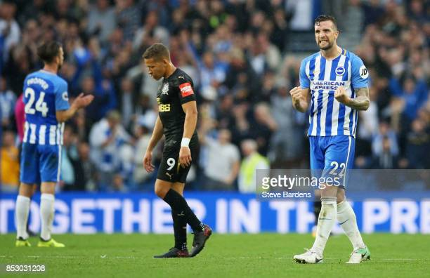 Shane Duffy of Brighton and Hove Albion celebrates victory as Dwight Gayle of Newcastle United looks dejected after the Premier League match between...