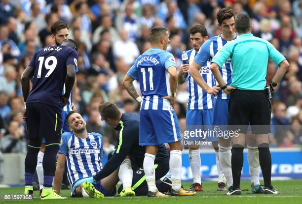 Shane Duffy of Brighton and Hove Albion lies injured prior to being replaced during the Premier League match between Brighton and Hove Albion and...