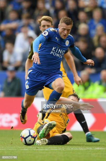 Shane Duffy of Brighton and Hove Albion tackles Jamie Vardy of Leicester City during the Premier League match between Leicester City and Brighton and...