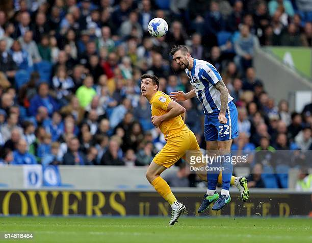 Shane Duffy of Brighton Hove Albion beats Jordan Hugill of Preston North End in an aerial battle during the Sky Bet Championship match between...