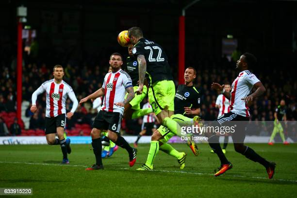 Shane Duffy of Brighton Hove Albion scores his team's second goal during the Sky Bet Championship match between Brentford and Brighton Hove Albion at...