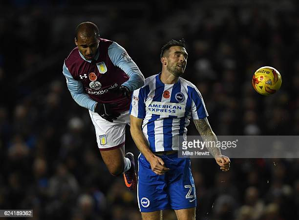 Shane Duffy of Brighton is challenged by Gabriel Agbonlahor of Aston Villa during the Sky Bet Championship match between Brighton Hove Albion and...