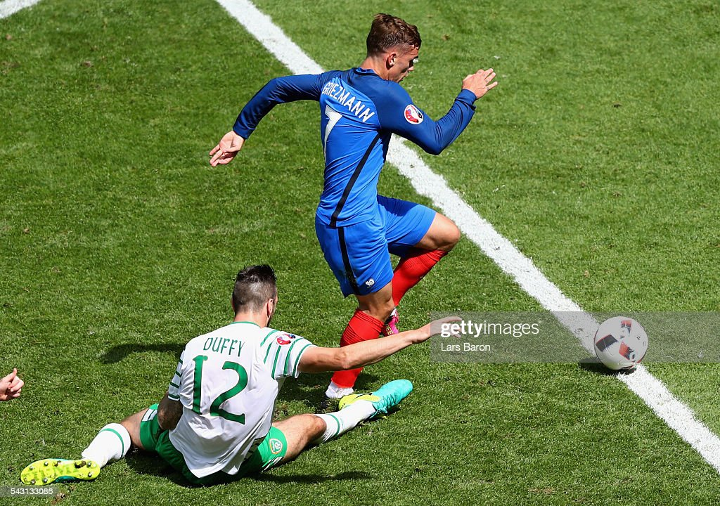Shane Duffy of Republic of Ireland fouls Antoine Griezmann of France resulting in a red card during the UEFA EURO 2016 round of 16 match between France and Republic of Ireland at Stade des Lumieres on June 26, 2016 in Lyon, France.