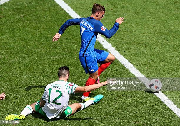 Shane Duffy of Republic of Ireland fouls Antoine Griezmann of France resulting in a red card during the UEFA EURO 2016 round of 16 match between...