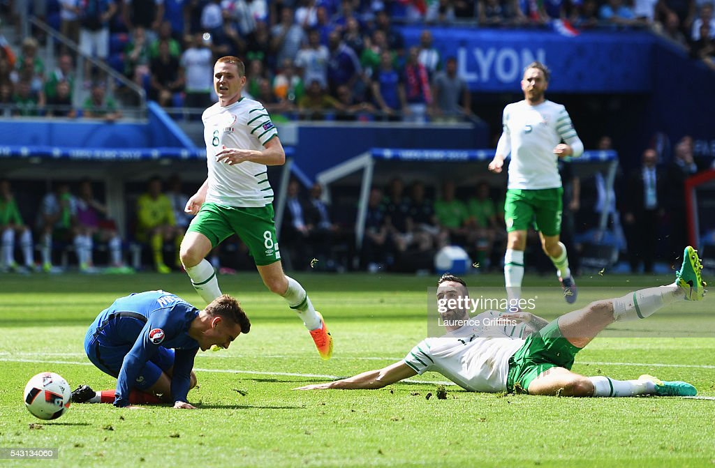Shane Duffy (R) of Republic of Ireland fouls Antoine Griezmann (L) of France resulting in a red card during the UEFA EURO 2016 round of 16 match between France and Republic of Ireland at Stade des Lumieres on June 26, 2016 in Lyon, France.