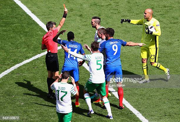 Shane Duffy of Republic of Ireland is shown a red card by referee Nicola Rizzoli after fouling Antoine Griezmann of France during the UEFA EURO 2016...