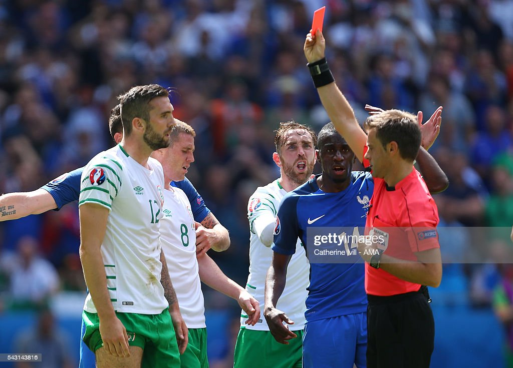 <a gi-track='captionPersonalityLinkClicked' href=/galleries/search?phrase=Shane+Duffy+-+Soccer+Player&family=editorial&specificpeople=16068436 ng-click='$event.stopPropagation()'>Shane Duffy</a> of Republic of Ireland receives a red card from Referee <a gi-track='captionPersonalityLinkClicked' href=/galleries/search?phrase=Nicola+Rizzoli&family=editorial&specificpeople=4238940 ng-click='$event.stopPropagation()'>Nicola Rizzoli</a> during the UEFA EURO 2016 Round of 16 match between France and Republic of Ireland at Stade des Lumieres on June 26, 2016 in Lyon, France.