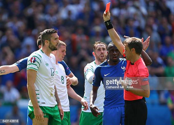 Shane Duffy of Republic of Ireland receives a red card from Referee Nicola Rizzoli during the UEFA EURO 2016 Round of 16 match between France and...