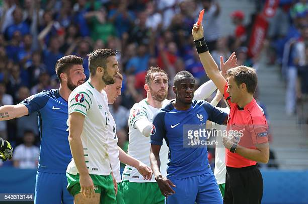 Shane Duffy of Republic of Ireland receives a red card from referee Nicola Rizzoli of Italy during the UEFA EURO 2016 round of 16 match between...
