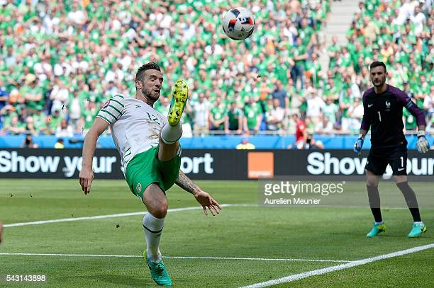 Shane Duffy of the Republic of Ireland controls the ball during the UEFA Euro 2016 round of 16 match between France and the Republic of Ireland at...