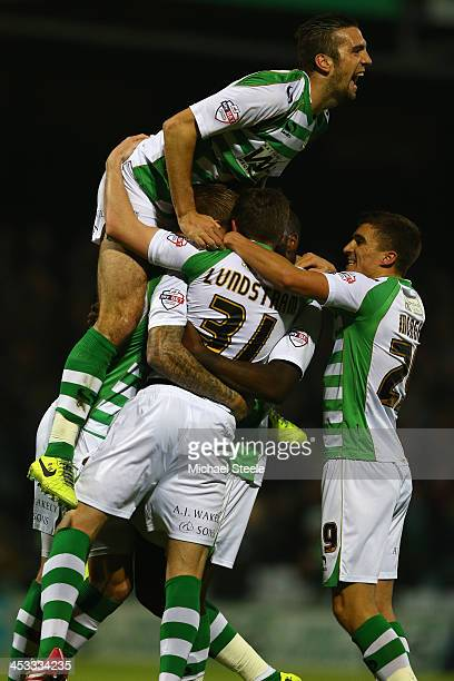 Shane Duffy of Yeovil Town leaps on goalscorer John Lundstram after the opening goal during the Sky Bet Championship match between Yeovil Town and...