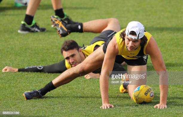 Shane Edwards of the Tigers and Daniel Rioli of the Tigers stretch during a Richmond Tigers AFL Media Opportunity and Training Session at Punt Road...