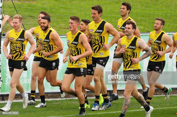 Shane Edwards of the Tigers and his teammates run during a Richmond Tigers AFL training session at Punt Road Oval on September 21 2017 in Melbourne...