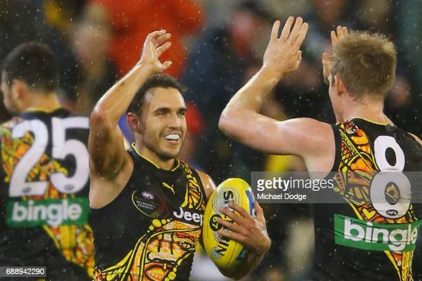 Shane Edwards of the Tigers celebrates the win on the final siren with Jack Riewoldt uring the round 10 AFL match between the Richmond Tigers and the...