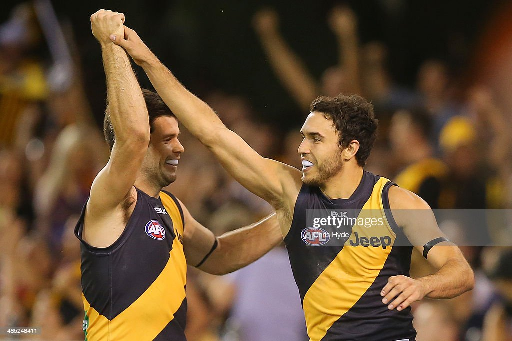 Shane Edwards of the Tigers celebrates with Trent Cochin after kicking a goal during the round five AFL match between the Brisbane Lions and the Richmond Tigers at The Gabba on April 17, 2014 in Brisbane, Australia.