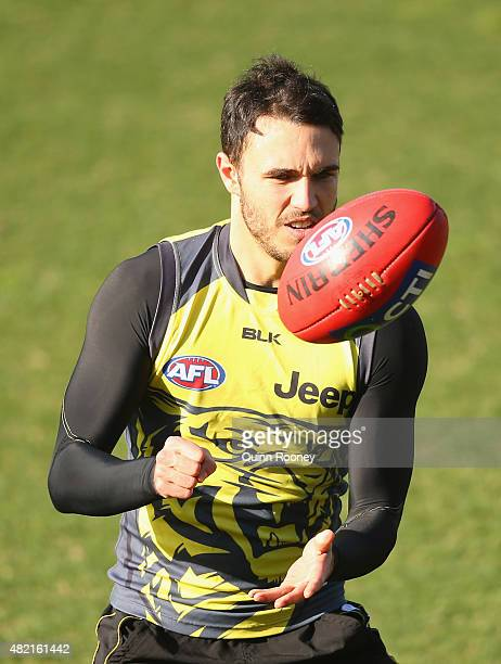 Shane Edwards of the Tigers handballs during a Richmond Tigers AFL training session at ME Bank Centre on July 28 2015 in Melbourne Australia