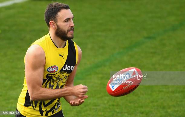 Shane Edwards of the Tigers handballs during a Richmond Tigers AFL training session at Punt Road Oval on September 19 2017 in Melbourne Australia