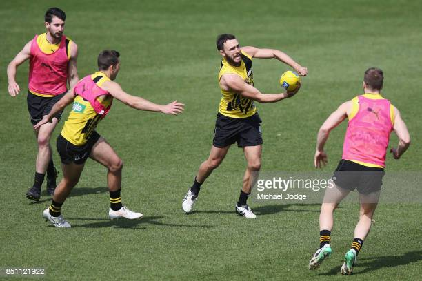 Shane Edwards of the Tigers handballs during a Richmond Tigers AFL training session at Punt Road Oval on September 22 2017 in Melbourne Australia