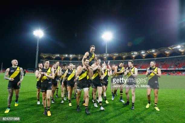 Shane Edwards of the Tigers is chaired off after his 200th game during the round 19 AFL match between the Gold Coast Suns and the Richmond Tigers at...